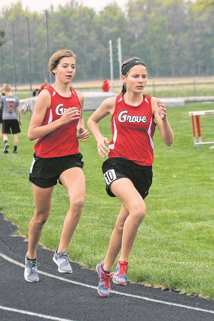 Erin Downing, left, and Alyssa Ellerbrock return for Columbus Grove and reaching state last year. Dean Brown | The Lima News