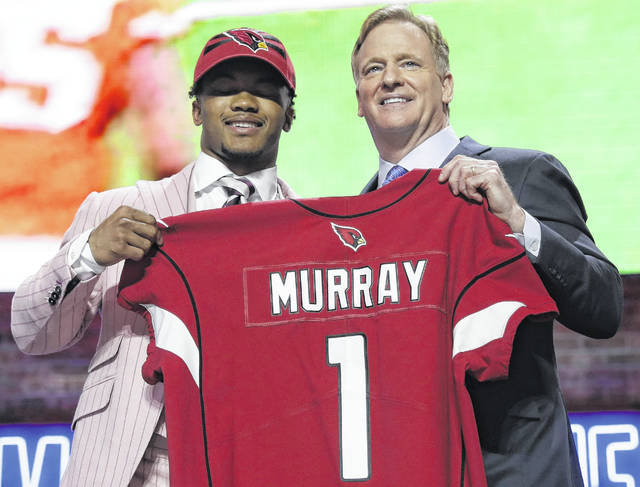Kyler Murray stands with NFL Commissioner Roger Goodell after Arizona selected him as the top pick in the NFL football draft Thursday in Nashville, Tenn.