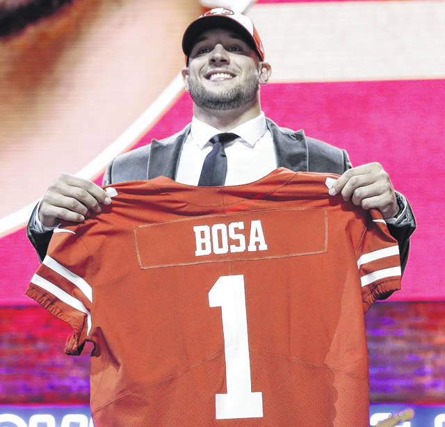 Nick Bosa sports a San Francisco jersey after being selected by the 49ers with the second pick of the NFL draft Thursday in Nashville, Tenn.