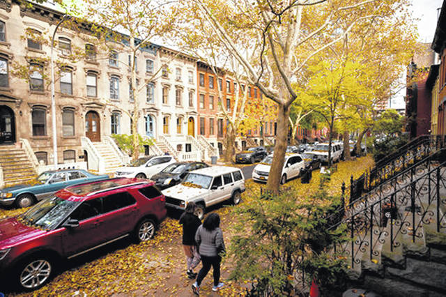 Fallen leaves cover cars and sidewalks on a tree-lined residential block in Long Island City in the Queens borough of New York in November 2018. How your parents prepare for retirement, long-term care and estate planning can affect your own financial future. Talking to them now can save your family headaches and messy conversations down the road.