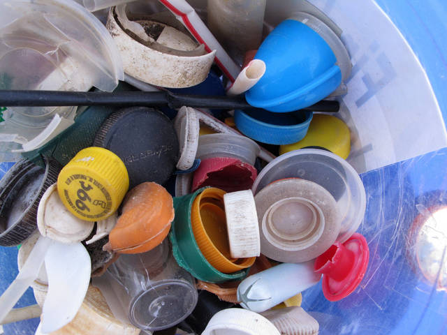 Some of the plastic caps collected by volunteers during cleanups of New Jersey's beaches last year are displayed Tuesday, April 2, 2019, in Sandy Hook, N.J. A report by the environmental group Clean Ocean Action found that volunteers picked up more than 450,000 pieces of litter from New Jersey's coastline last year. (AP Photo/Wayne Parry)