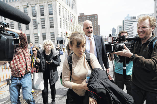Actress Allison Mack leaves Brooklyn federal court on Monday. Mack pleaded guilty to racketeering charges in a case involving a cult-like group based in upstate New York.