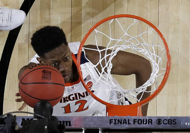 Virginia's De'Andre Hunter (12) goes up for a basket during the first half in the championship of the Final Four NCAA college basketball tournament against Texas Tech, Monday in Minneapolis.