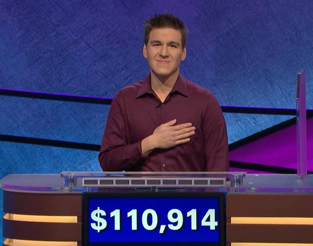 "This image made from video aired on ""Jeopardy!"" on Tuesday, April 9. 2019, and provided by Jeopardy Productions, Inc. shows James Holzhauer.  The 34-year-old professional sports gambler from Las Vegas won more than $110,000 on ""Jeopardy!"" on Tuesday, breaking the record for single-day cash winnings. (Jeopardy Productions, Inc. via AP)"