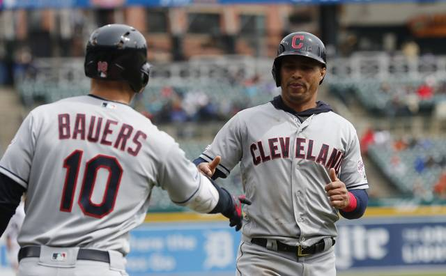 Cleveland Indians center fielder Leonys Martin is greeted by teammate Jake Bauers after scoring on a double by Jose Ramirez during the sixth inning of a baseball game against the Detroit Tigers Wednesday.