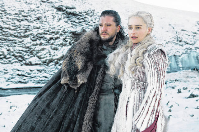 """This photo released by HBO shows Kit Harington as Jon Snow, left, and Emilia Clarke as Daenerys Targaryen in a scene from """"Game of Thrones,"""" which premiered its eighth season on Sunday."""