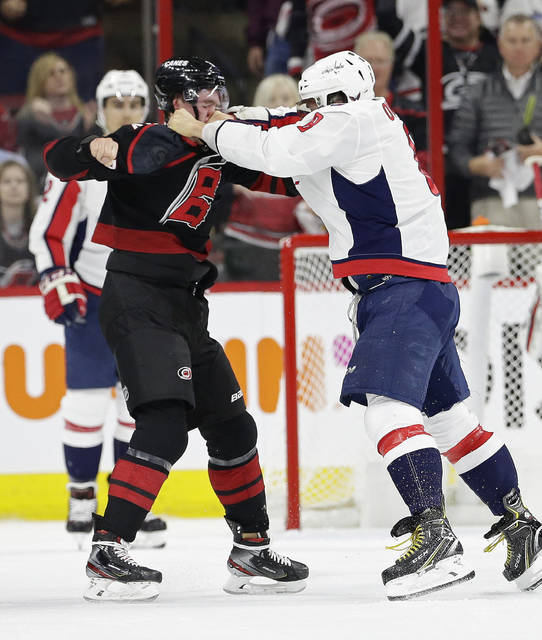 Washington Capitals' Alex Ovechkin, right, of Russia, punches Carolina Hurricanes' Andrei Svechnikov, also of Russia, during the first period of Game 3 of an NHL hockey first-round playoff series in Raleigh, N.C., Monday.