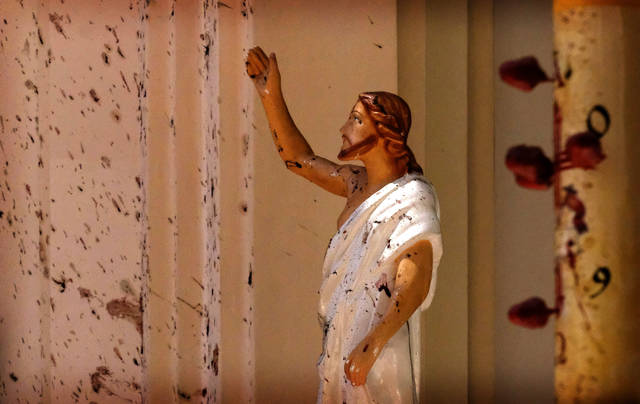 Blood stains are seen on the wall and on a Jesus Christ statue at St. Sebastian's Church after Sunday's blast on Easter in Negombo, north of Colombo, Sri Lanka. More than 200 people were killed and hundreds more injured in eight blasts that rocked churches and hotels in and just outside Sri Lanka's capital on Easter Sunday.