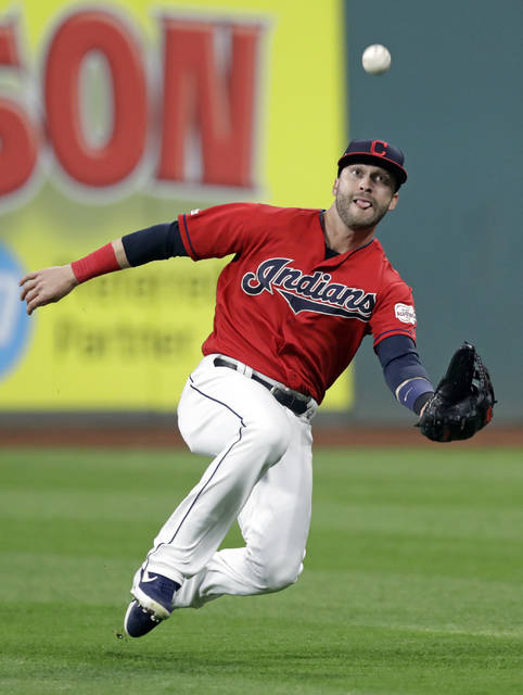 Cleveland Indians' Tyler Naquin catches a ball hit by Atlanta Braves' Dansby Swanson in the fourth inning of a baseball game, Sunday in Cleveland. Swanson was out on the play.