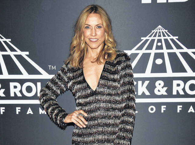 "FILE - This March 29, 2019 file photo shows Sheryl Crow attending the Rock & Roll Hall of Fame induction ceremony in New York.  Crow has released ""Redemption Day,"" a political and spiritual song about war featuring vocals from the late Johnny Cash that will be featured on what she says is her last album. The song is from her upcoming album for Valory Music Co., which will also include duets with Keith Richards, Stevie Nicks and Eagles members Don Henley and Joe Walsh among others. No release date for the album has been announced. (Photo by Evan Agostini/Invision/AP, File)"
