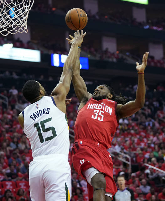 Houston Rockets forward Kenneth Faried (35) is blocked by Utah Jazz forward Derrick Favors (15) during the first half in Game 5 of an NBA basketball playoff series, in Houston Wednesday.