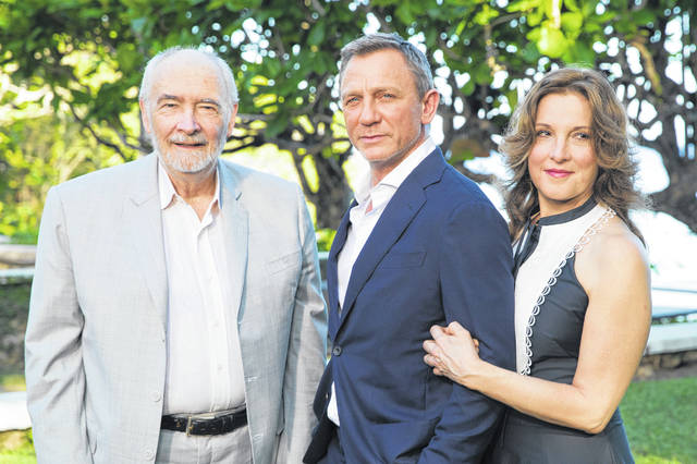 Producers Michael G Wilson, left, and Barbara Broccoli, right, pose for photographers with actor Daniel Craig during the photo call of the latest installment of the James Bond film franchise, currently known as Bond 25, in Oracabessa, Jamaica, on Thursday.