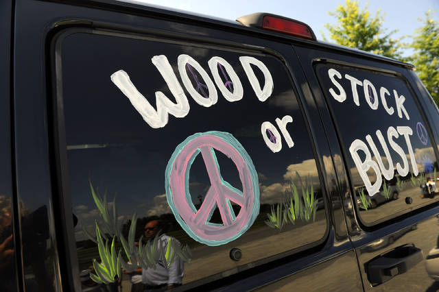 "FILE - This Aug. 14, 2009 file photo shows a van decorated with ""Woodstock or Bust"" at the original Woodstock Festival site in Bethel, N.Y.  Woodstock 50 is proving to be as chaotic as the original festival held in 1969. A financial investor in the festival announced Monday, April 29, 2019, it was pulling its funding from the anniversary event, set to take place Aug. 16-18 in Watkins Glen, N.Y. (AP Photo/Stephen Chernin, File)"