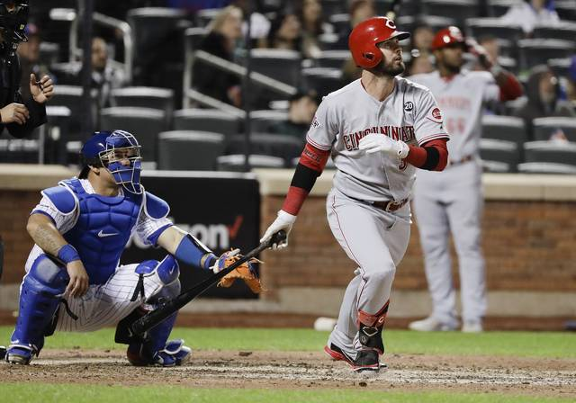 Cincinnati Reds' Jesse Winker, front right, watches his home run during the ninth inning of a baseball game against the New York Mets, Monday in New York.