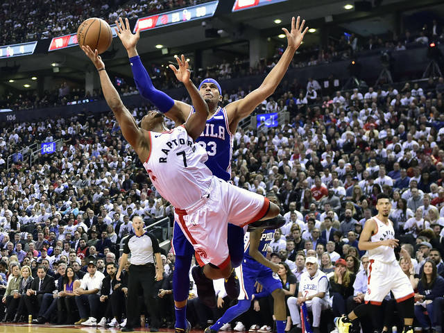 Toronto Raptors guard Kyle Lowry (7) draws a foul on Philadelphia 76ers forward Tobias Harris (33) as he drives to the net during second-half, second-round NBA basketball playoff action in Toronto, Monday.