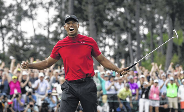 Tiger Woods reacts after winning the Masters Tournament on Sunday. It was his first win in a major tournament since the 2008 U.S. Open and his first win in the Masters since he won that tournament 14 years ago.