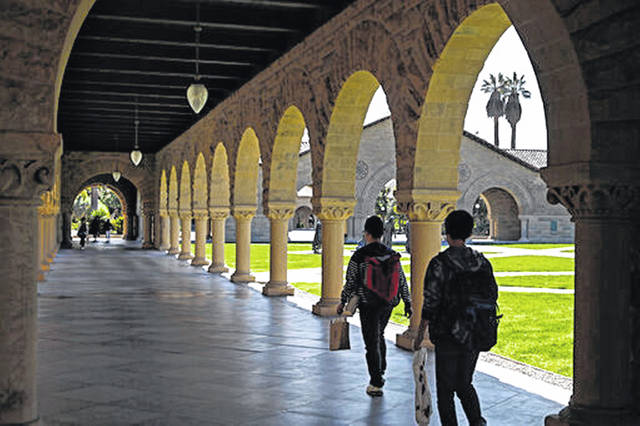 People walk on the Stanford University campus in Santa Clara, Calif. Whether you're asking your parents for financial help, or they're offering it, think twice before accepting. If Mom and Dad aren't on track for retirement, it could end up costing everyone.
