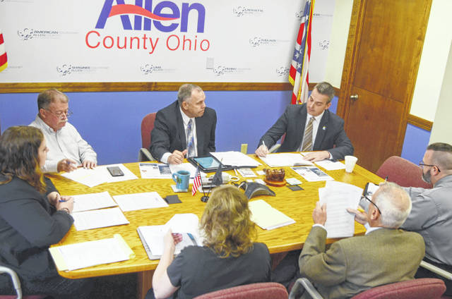 County and city officials discuss the final details of the agreement creating the Allen County Building Department during a Tuesday morning meeting.