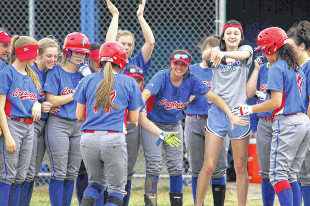 Crestview's Lexi Gregory is greeted at home after hitting a solo home run in the second inning of Thursday's game at Allen East.