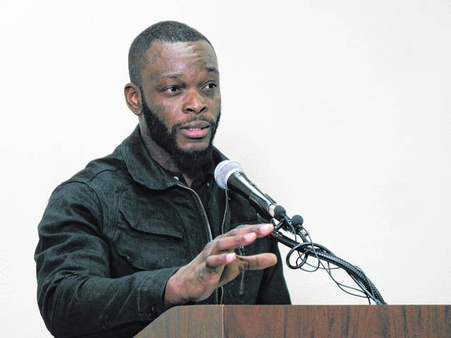 Shamieke Pugh recounts being stabbed by a fellow inmate at an Ohio prison and discusses a related new lawsuit against prison officers during a news conference Wednesday, April 3, 2019, in Columbus, Ohio. The lawsuit alleges officers at an Ohio prison watched as an inmate slipped his handcuffs, pulled out a blade, and stabbed Pugh and three other fellow prisoners who were handcuffed to a table. The civil rights lawsuit filed Wednesday by two of the injured men alleges officers hadn't strip-searched the attacker as required and didn't provide first aid to the bleeding inmates.