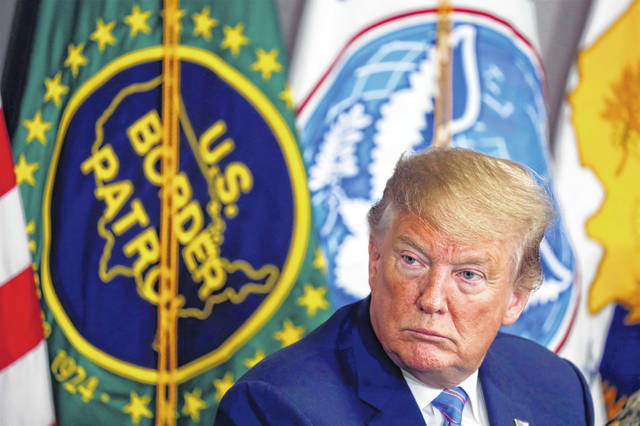 President Donald Trump participates in a roundtable on immigration and border security at the U.S. Border Patrol Calexico Station in Calexico, Calif., Friday April 5, 2019. Trump headed to the border with Mexico to make a renewed push for border security as a central campaign issue for his 2020 re-election. (AP Photo/Jacquelyn Martin)