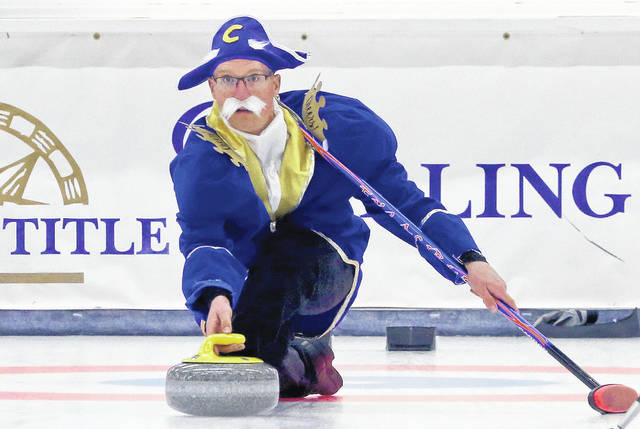 In this Thursday, April 4, 2019 photo, dressed as the cereal cartoon character Cap'n Crunch, Joe Welch throws a stone during the 84th Fairbanks International Bonspiel Thursday night, April 4, 2019 at the Fairbanks Curling Club in Fairbanks, Alaska.