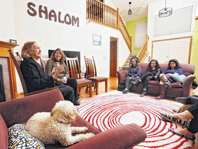 "In a April 4, 2019 photo, Holocaust survivor Trudy Blumenstein, left, accompanied by daughter Deborah Kramer shares her story at the home of Mike and Laura Dattner in Dublin, Ohio. Jewish Columbus calls this event Zikaron Basalon, which translates as ""remembrance in the living room."""