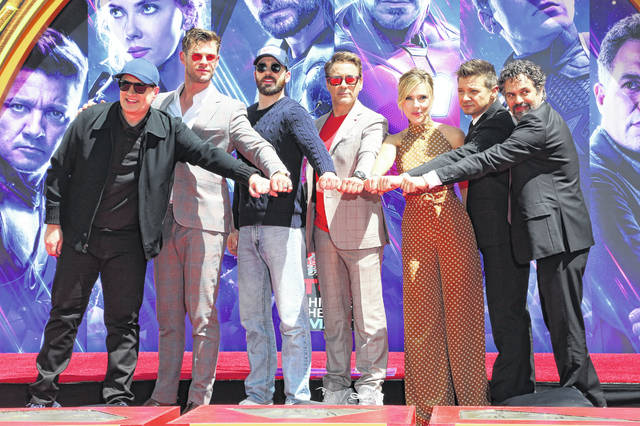 "Marvel Studios President Kevin Feige, from left, poses with members of the cast of ""Avengers: End Game,"" Chris Hemsworth, Chris Evans, Robert Downey Jr., Scarlett Johansson, Jeremy Renner and Mark Ruffalo at a hand and footprint ceremony at the TCL Chinese Theatre on Tuesday, April 23, 2019, in Los Angeles."