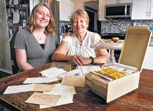 In this April 18, 2019 photo, Krista Horrocks and her mom Becky Wagner look through recipe cards from Becky's mom Nellie Colgin that have been handed down from one generation to another in Hilliard, Ohio.