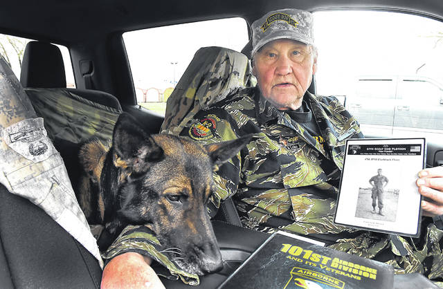 """To this day the Vietnam War touches U.S. Army veteran Allen Mathews. He calls fallen Vietnam veteran and friend Gary Detrick his """"guardian angel"""" and to this day carries Detrick's photo in his truck. Matthews also has a retired Army dog named Yanos as a pet. Detrick, a 1966 graduate of Wapakoneta High School, died in a firefight in Vietnam 50 years ago Saturday. Craig J. Orosz 