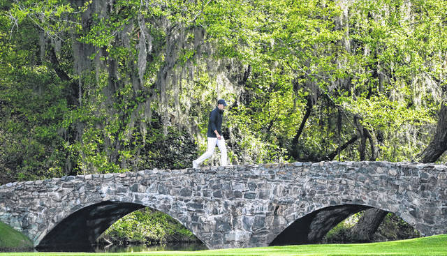 Jordan Spieth walks across the Nelson Bridge on the 13th hole during the fourth round at the Masters golf tournament in 2018. Spieth has been in the Sunday mix at all five Masters he has played.