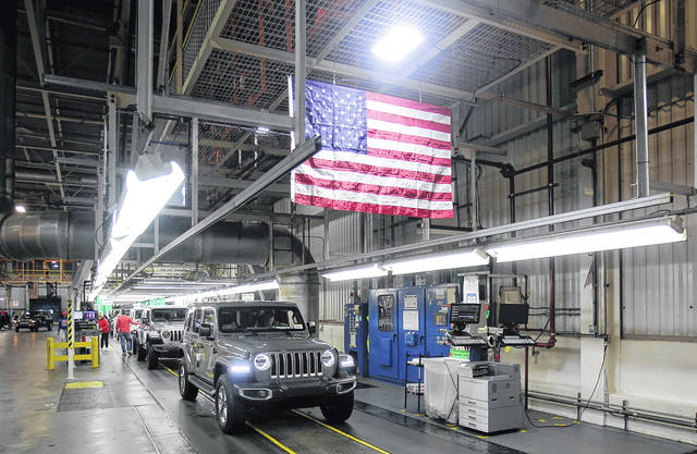 A Jeep Wrangler comes off the final production line at the Toledo North Assembly Plant in Toledo, Ohio on Friday, November 16, 2018. (Eric Seals/Detroit Free Press/TNS)