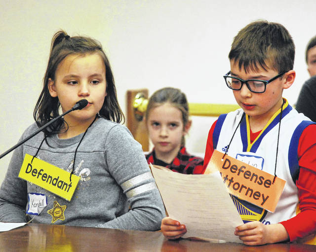 Defendant Kendall Walsh and Defense Attorney Kaidyn Garrity pleaded their case during a mock trial staged by Bath third-graders Monday in Allen County Common Pleas Court.