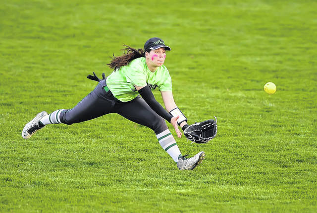 Celina's Karissa Frederick dives for a fly ball against Bath during Tuesday's game at Bath High School.