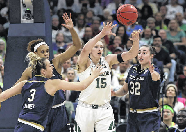 Baylor forward Lauren Cox (15) passes the ball as she is surrounded by Notre Dame guard Marina Mabrey (3), forward Brianna Turner and forward Jessica Shepard (32) during the women's basketball NCAA championship game on Sunday night in Tampa, Fla.