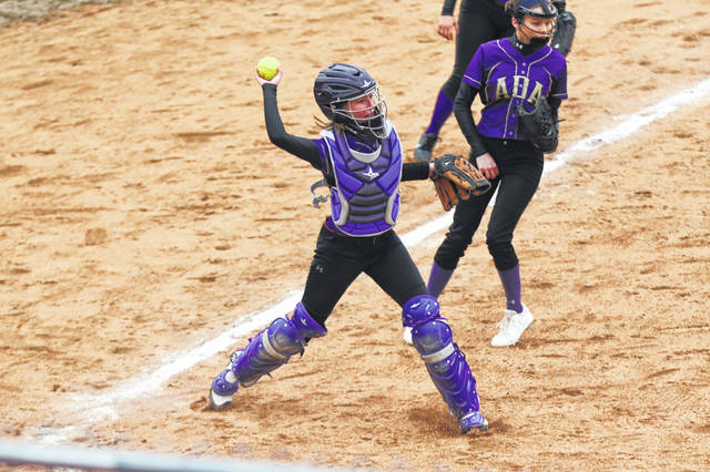 Ada's Aubrey Madison fields a bunt and throw on to first to secure the out during Thursday's game at Bluffton.