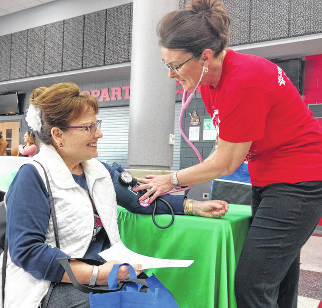 Leslie Gordon of Lima gets her blood pressure checked by Yvette Hauenstein, a nurse at Lima Memorial Health System.