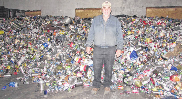 Joe Hohlbein, Putnam County Recycling Center supervisor, stands in front of recyclable materials at the existing Ag Annex Building at the fairgrounds. There is a proposal for the recycling processing to move to a larger building at the current location on Second Street at the fairgrounds.