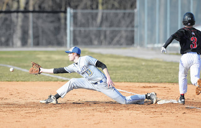 Delphos St. John's Luke Reindel stretches for a throw against Shawnee's Joey Azzarello during Monday's game at Stadium Park in Delphos.