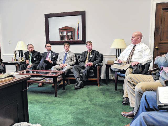 Area farmers visited representatives in Washington last month. Left to right on the couch are Gene Daniel, Seneca County Farm Bureau president; Seth Middleton, Shelby County Farm Bureau president; John Hafer, Marion County Farm Bureau president; and Gary Mescher, Mercer County Farm Bureau president. They spoke to Jared Dilley, in place of U.S. Rep. Jim Jordan, R-Urbana, during the 73rd Ohio County Farm Bureau Presidents' Trip to Washington, D.C., on March 14.