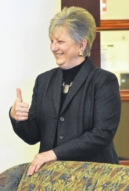 Dr. Cynthia Spiers gives a thumbs up while being introduced as the interim president at Rhodes State College on Wednesday morning. Spiers had been the special assistant to the president at Rhodes. She previously served as the vice president of student affairs and as director of institutional effectiveness and planning there.