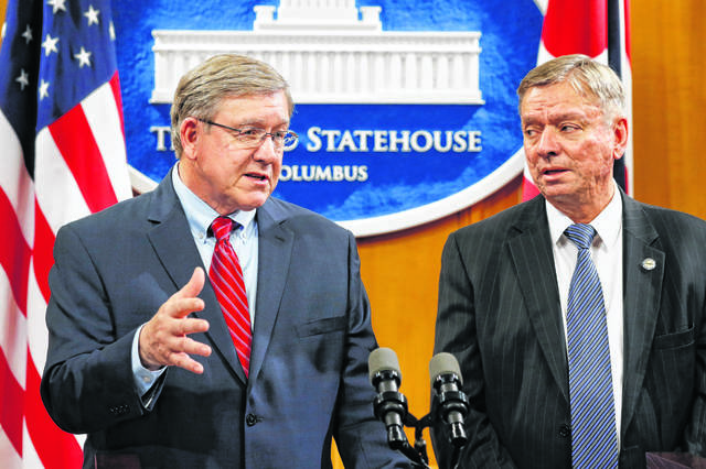 Ohio State Reps. Bob Cupp, R-Lima, left, speaks alongside John Patterson, D-Jefferson, as they announce their proposed overhaul of Ohio's school funding formula at the Statehouse in Columbus, Monday, March 25, 2019.