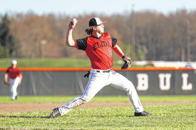 Elida's TJ Whipple throws to first during Tuesday's home game against Bath.