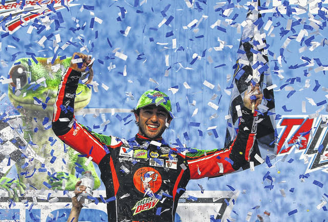 Chase Elliott celebrates after winning a NASCAR Cup Series auto race at Talladega Superspeedway, Sunday, April 28, 2019, in Talladega, Ala. (AP Photo/Butch Dill)