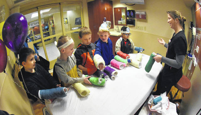 "Lisa VonDrell, a registered nurse at Joint Township Hospital in St. Marys, explains how an emergency room works and lets kindergarten students from Botkins try on arm cast. The ""Make Believe Hospital"" program aims to alleviate common childhood fears about the hospital."