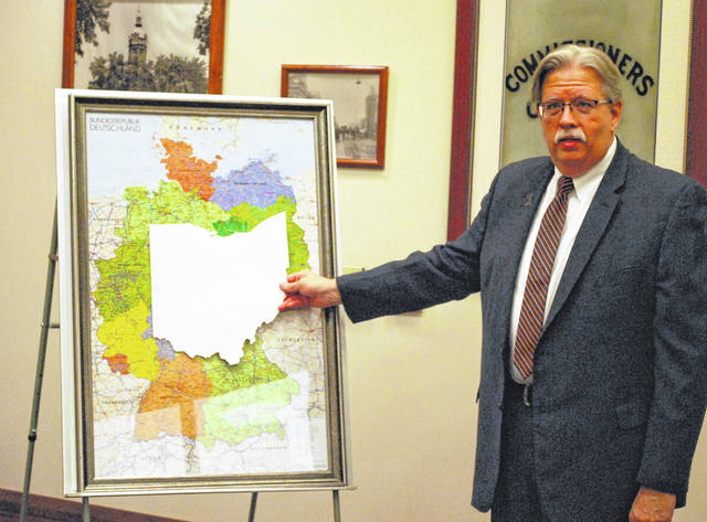 Gregory Myers, executive director of the Wapakoneta Area Economic Development Council, illustrated the size of Ohio as compared to Germany during a press conference Thursday to announce a partnership with the Berlin-based Transatlantic Business Investment Council.