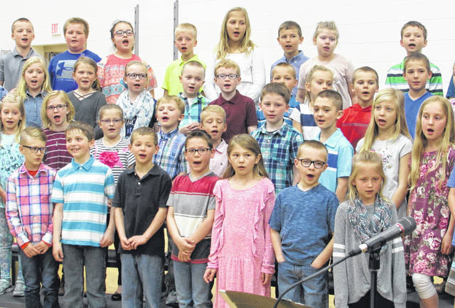 Glandorf Elementary second- and third-grade students sing during a musical performance Thursday at the school.