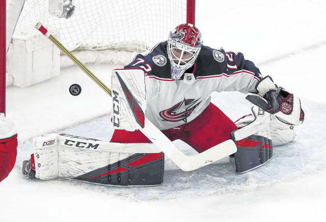 Columbus Blue Jackets goaltender Sergei Bobrovsky makes a save against the Boston Bruins during the first overtime of Game 2 of an NHL hockey second-round playoff series, Saturday, April 27, 2019, in Boston. (AP Photo/Charles Krupa)
