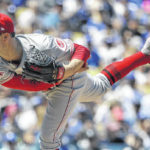 Dodgers power past Reds