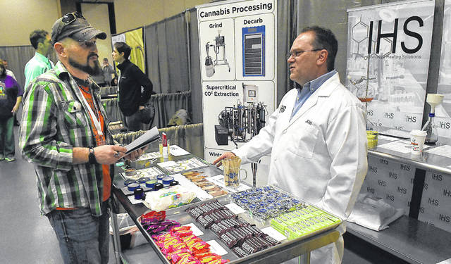 Guest speaker Darrell Leffingwell, left, and John Stepleton, CFO of IHS in Spencerville, converse at the Ohio Holistic Health & Cannabis Expo at Veterans Memorial Civic Center in Lima on Friday. Leffingwell will discuss a veteran's view on medical cannabis during the expo.